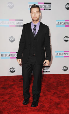 Lance Bass added a pop of color to his black suit with a purple collared shirt.