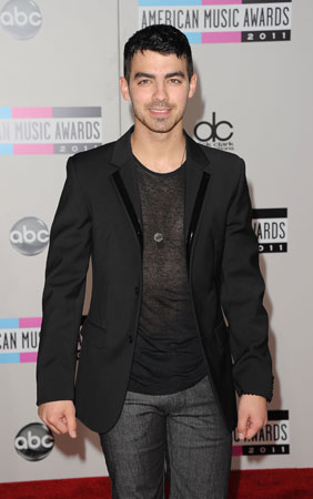Joe Jonas arrived in a blazer and t-shirt.