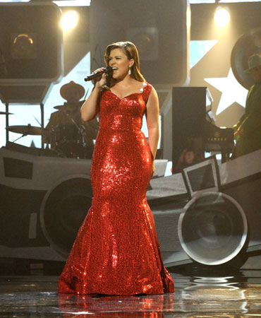 Kelly Clarkson wore a floor-length red dress during her performance.