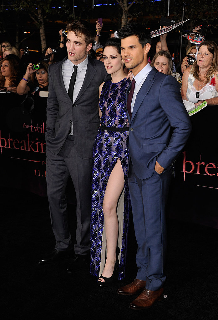 Kristen was flanked by her handsome men.