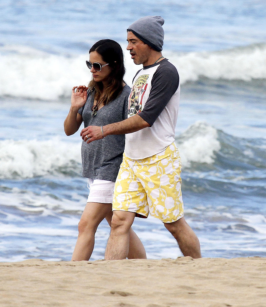 Robert Downey Jr. and his pregnant wife, Susan, on the beach in Kauai.