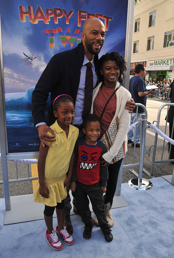 Common posed with his daughter, Omoye Assata Lynn, at the Happy Feet Two premiere in LA.