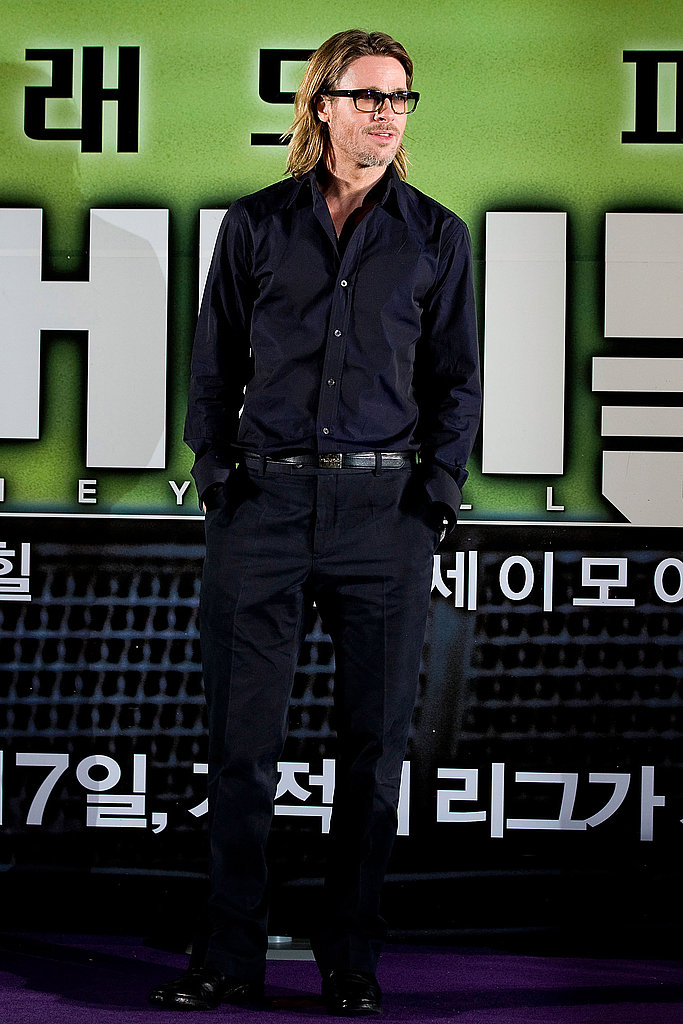 Brad Pitt posed for photos at a Seoul press conference for his movie Moneyball.
