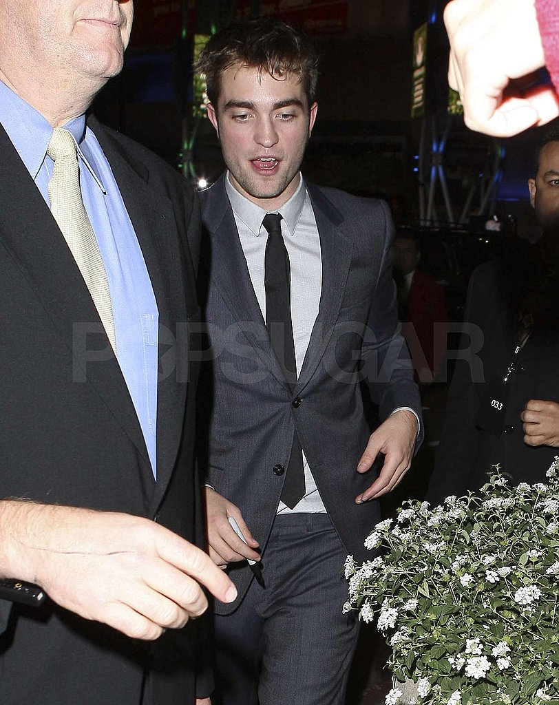 Robert Pattinson stayed suited up for the afterparty.