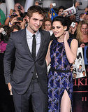 Kristen Stewart playfully put her hand on her neck while posing next to Robert Pattinson.