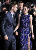 Kristen Stewart put an arm around Robert Pattinson to pose for photos.