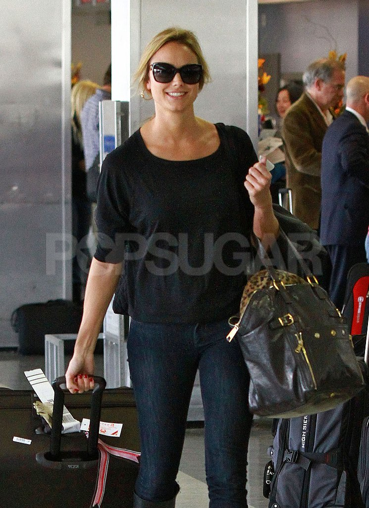 Stacy Keibler smiled at the air port.