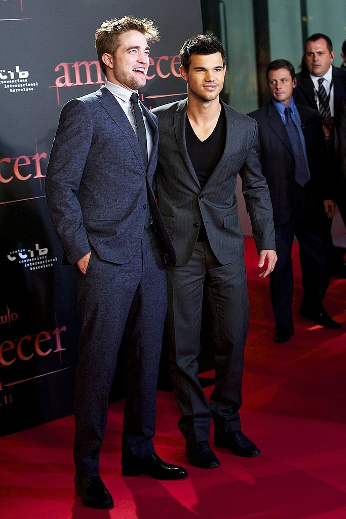 Taylor Lautner with Robert Pattinson at the Breaking Dawn Part 1 premiere in Spain.