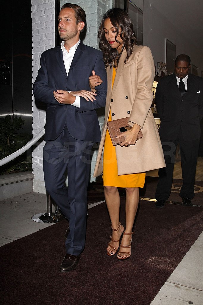 Zoe Saldana wore a bright Michael Kors dress to dinner.