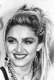 Isn't this how most of us remember Madonna? The Material Girl sat for an AMA press conference in 1985.