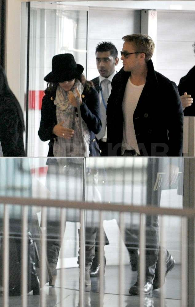 Ryan Gosling and Eva Mendes at Charles de Gaulle Airport.