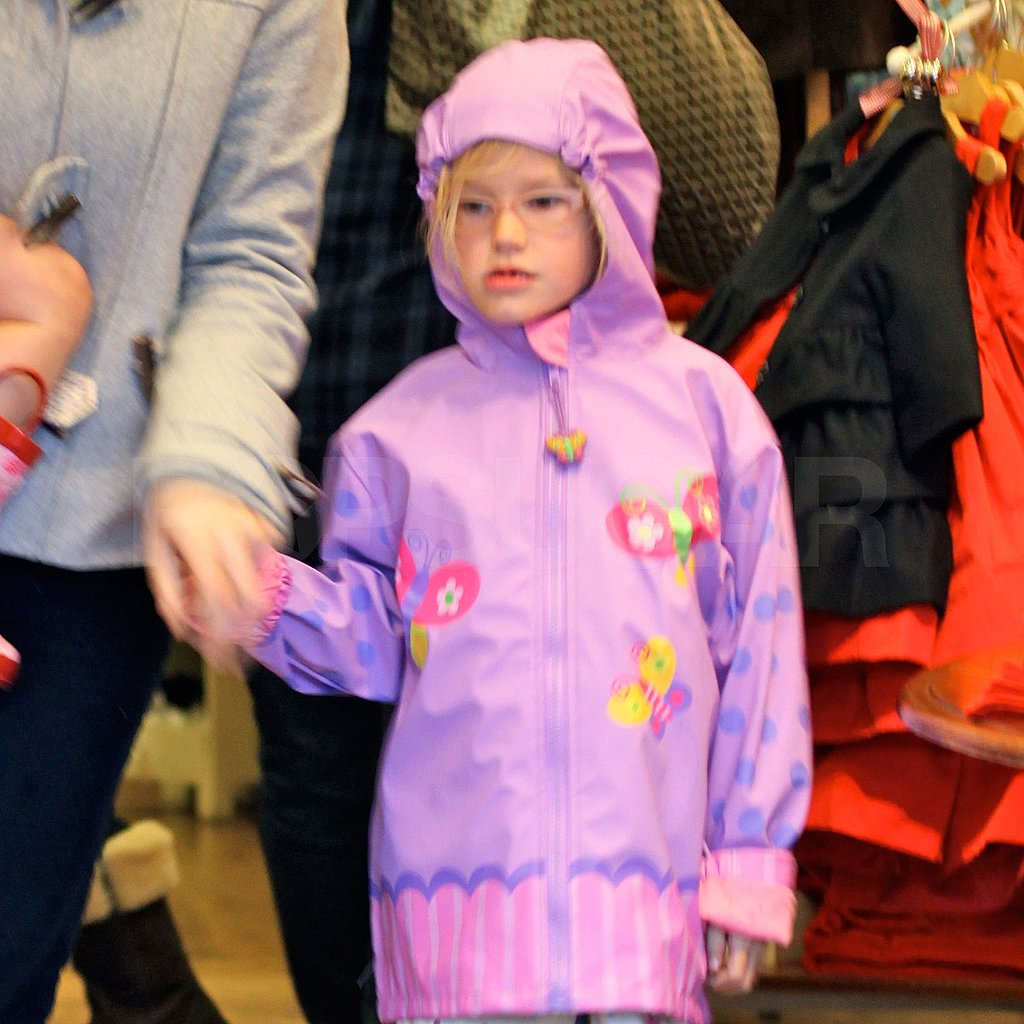 Violet Affleck wore a purple raincoat.