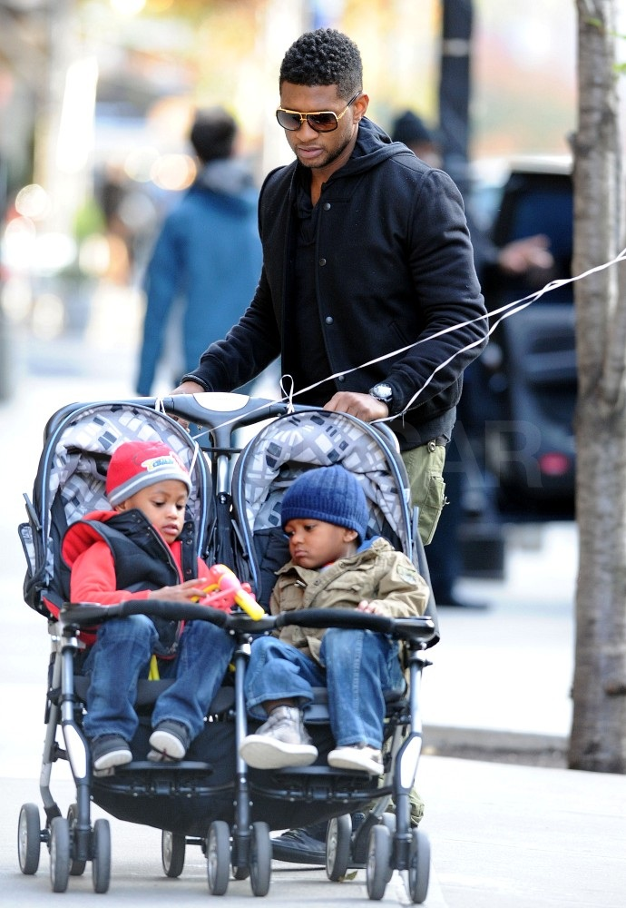 Usher pushed his sons, Naviyd and Cinco, around the city.