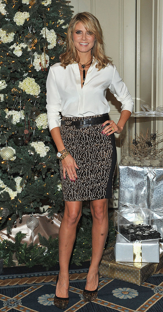 Heidi Klum wore a white button-down and a pencil skirt for her event.
