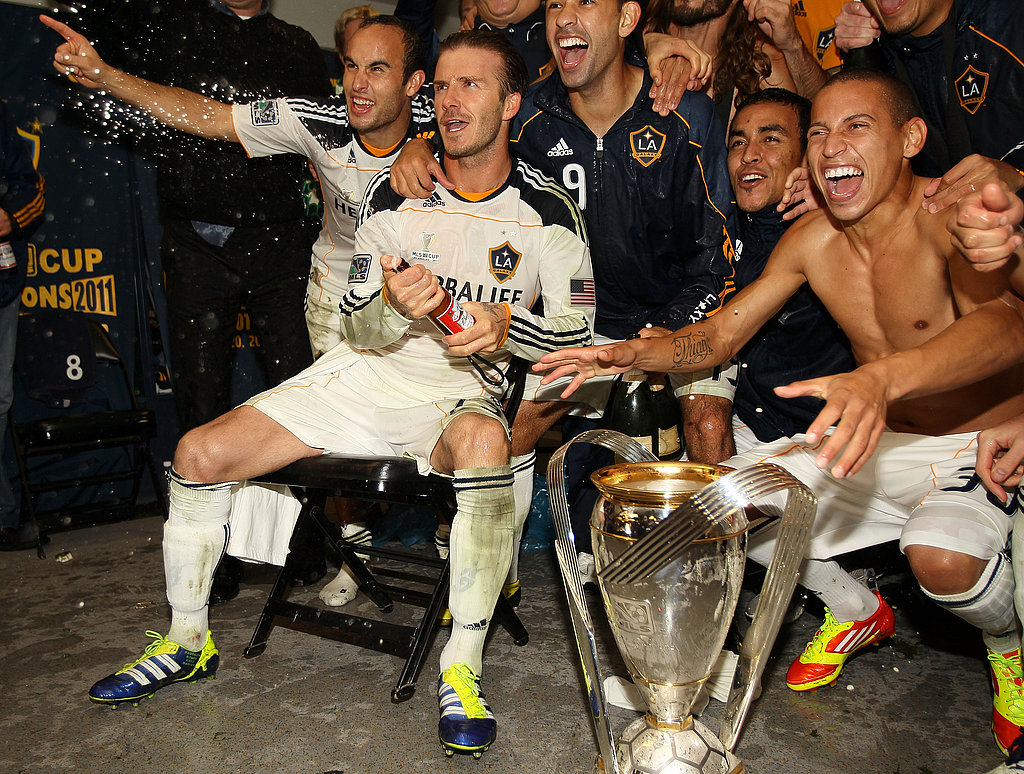 David Beckham cracked open a bottle of champagne to celebrate.