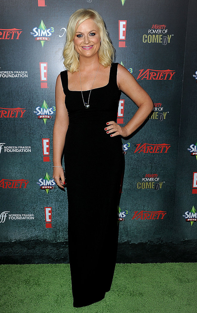 Amy Poehler struck a pose on the green carpet.