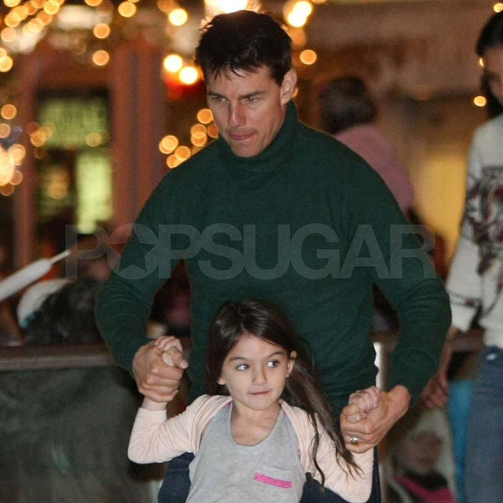Tom Cruise ice-skating with Suri.