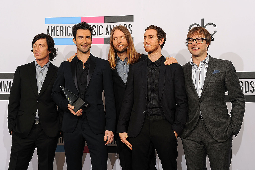 Maroon 5's Adam Levine, James Valentine, Jesse Carmichael, Mickey Madden and Matt Flynn snapped a photo with their new American Music Award.
