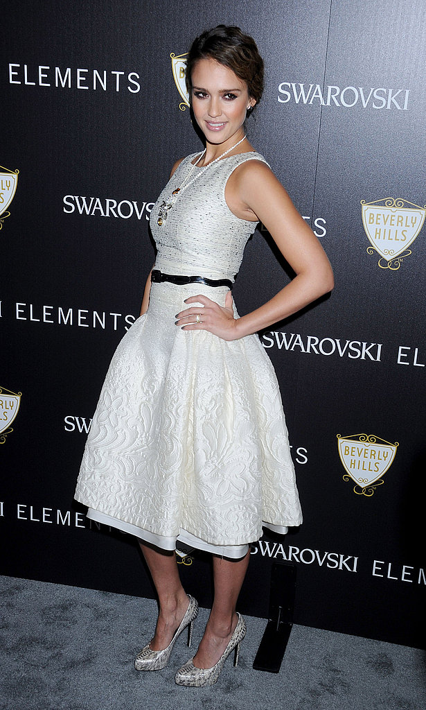 Jessica Alba wore a pretty white dress at a Swarovski party.