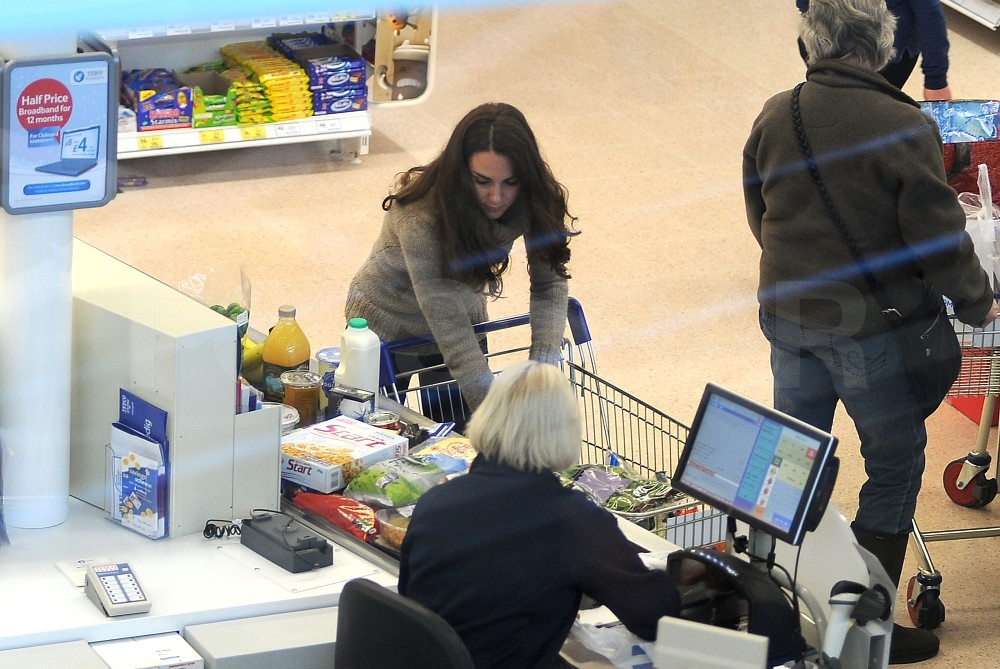 Kate unloaded her cart at Tesco.