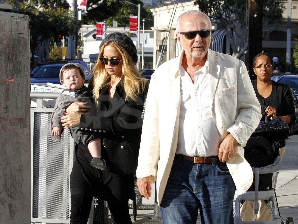 Rachel Zoe carried Skyler Berman, while her father, Ron Rosenzweig, walked ahead.