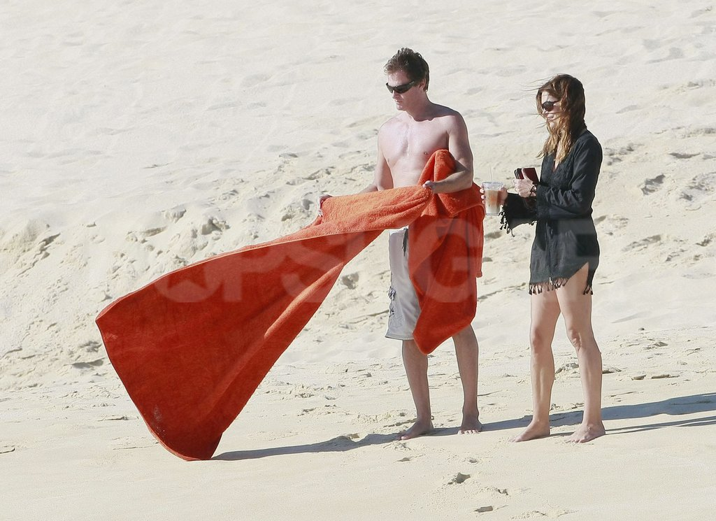 Rande Gerber spread out a blanket for Cindy Crawford.