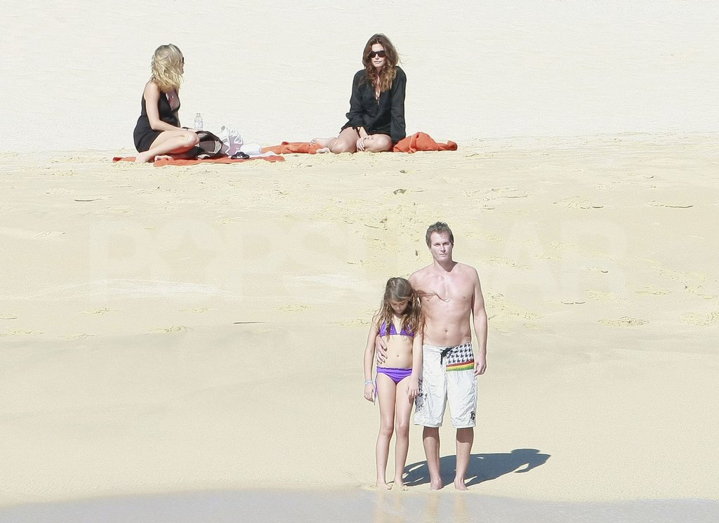 Cindy Crawford watched Rande Gerber and her daughter, Kaia, walk to the water in Mexico.