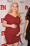 Jessica Simpson showed off her growing baby bump in a tight red dress.