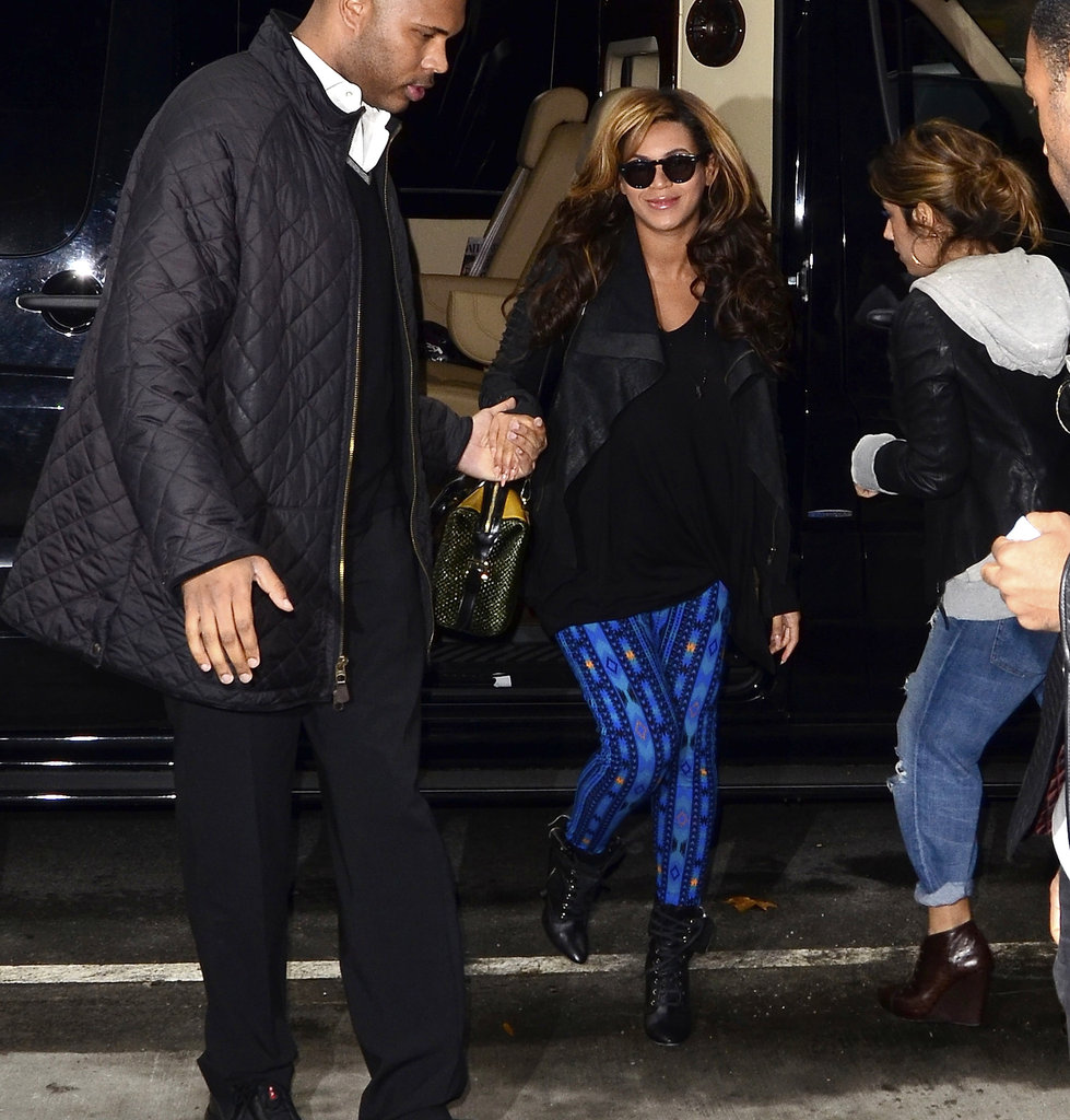 Beyoncé Knowles in blue pants.