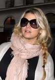 Jessica Simpson in a pink scarf.
