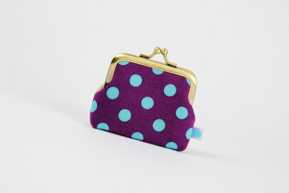 We love the adorable print on this little coin purse, the ideal find to keep loose chain from jangling around in the bottom of your purse. Deep Mum Etsuko Dots'n Stripes Metal Frame Purse ($20)