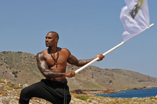Tyson waved a white flag to summon the girls to the top of the mountain.  Photo courtesy of The CW