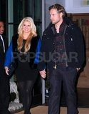 Eric Johnson held the pregnant Jessica Simpson's hand.