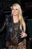 Jessica Simpson in a leopard dress.