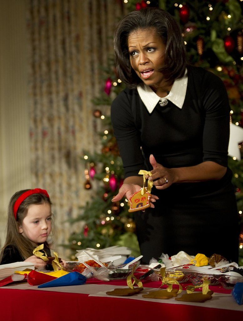Michelle Obama shows off her decorated cookie.
