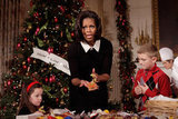 Michelle Obama shows her handmade cookie Christmas ornament.