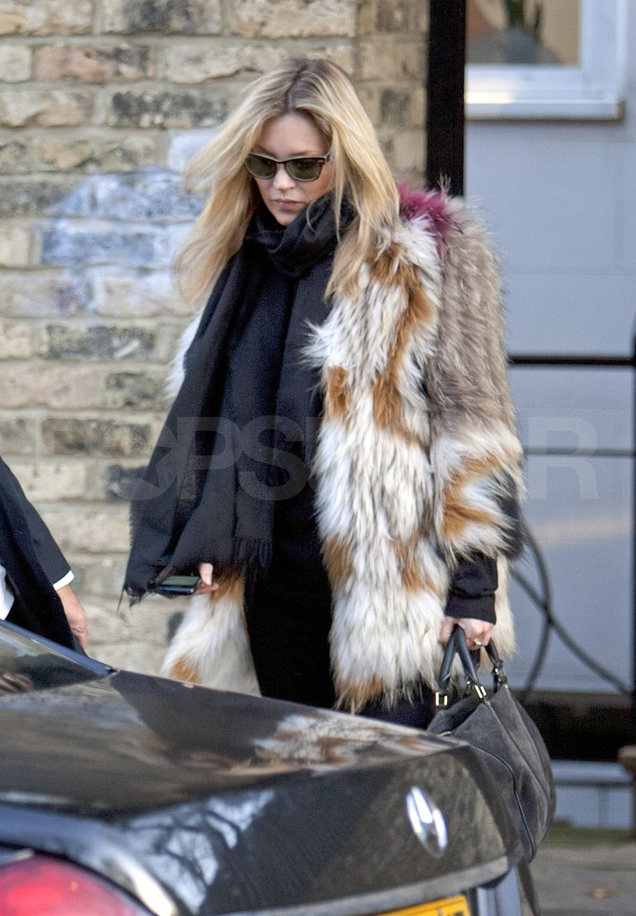 Kate Moss left her London home to run errands.