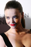Miranda Kerr's look popped with red lipstick.