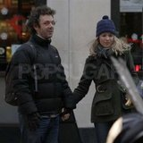 Rachel McAdams and Michael Sheen holding hands.