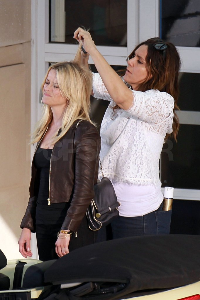 Reese Witherspoon had her hair teased between takes.