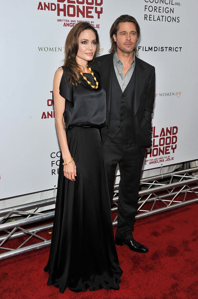 Angelina Jolie and Brad Pitt both wore black for the premiere of her latest film, In the Land of Blood and Honey.