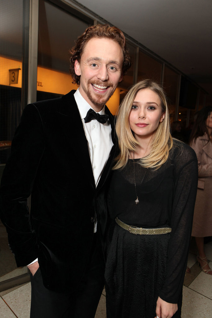 Elizabeth Olsen and Tom Hiddleston caught up at the NYC premiere of War Horse.