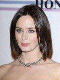 Emily Blunt in a delicate necklace.