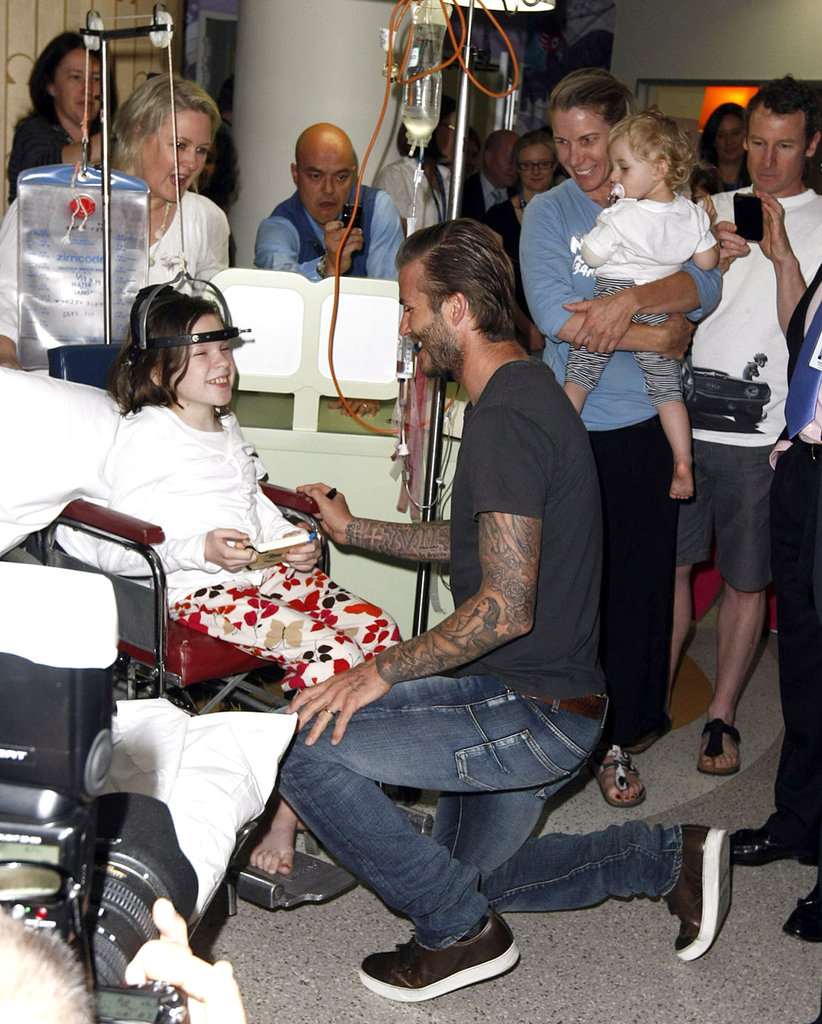 David Beckham kneeled down to say hello to a young fan.