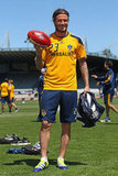 David Beckham toyed around with a rugby ball.