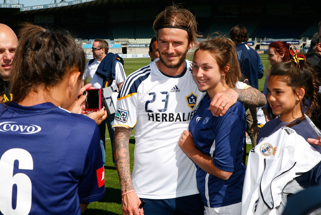 David Beckham posed for photos with fans.
