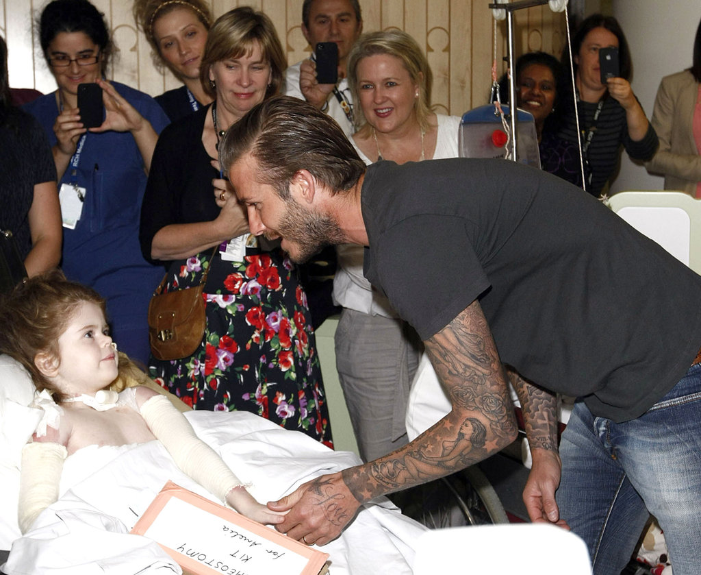 David Beckham greeted a young girl.