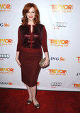 Christina Hendricks got into the holiday spirit in a red sequined cardigan and pencil skirt at Trevor.