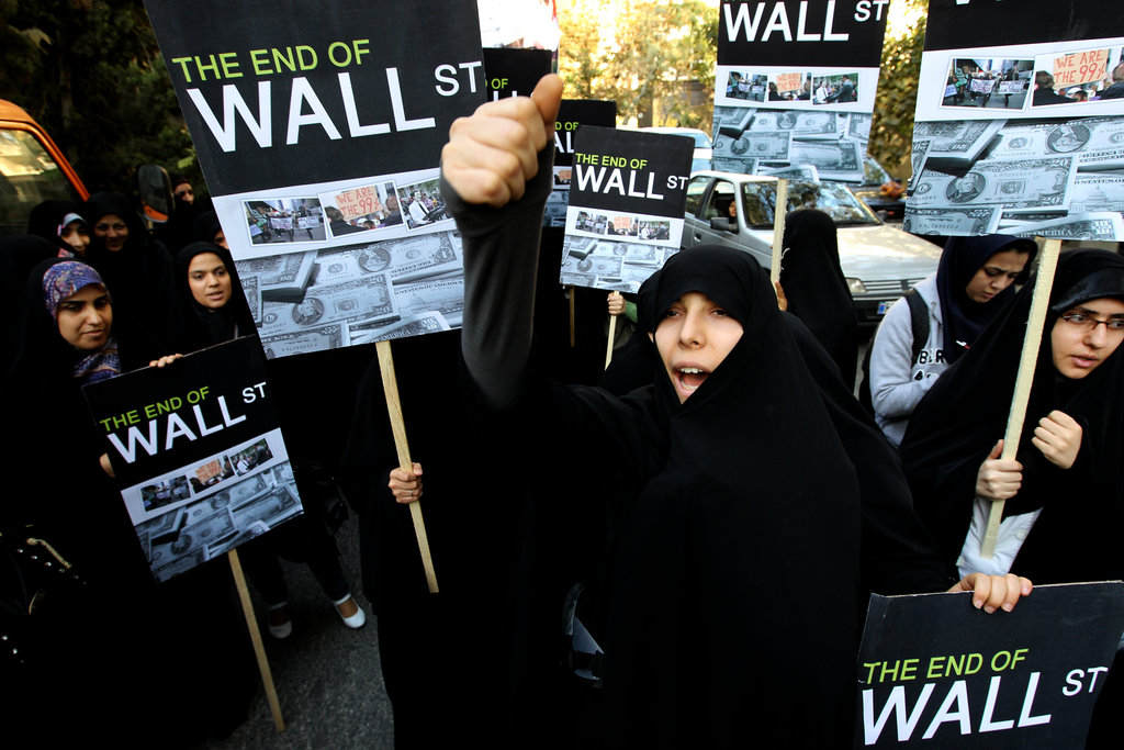 Iranian women supported Occupy Wall Street outside the Swiss embassy in Tehran.