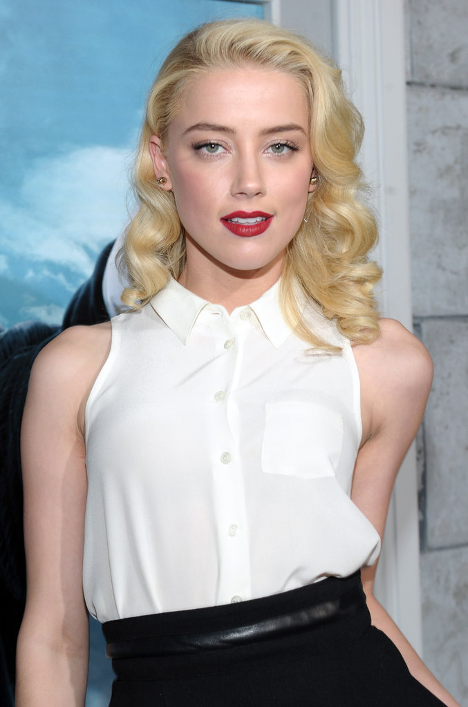 Amber Heard in a sleeveless white shirt.